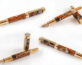 Awesome fountain pen in gold titanium and a wood - acrylkic hybrid that looks like marble