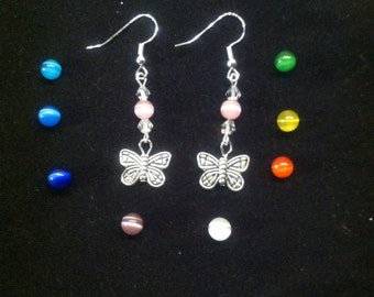 Butterfly charm earrings with your choice of Catseye bead.