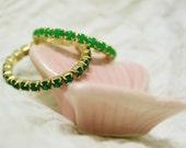 Set of emerald green rings