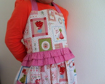 Girl's apron, vintage pattern style pink and white fabric.
