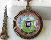 The Heart Chakra (green, fourth, 4), Anahata. Pendant Antiqued Copper. Circle Glass Tile Art Photo