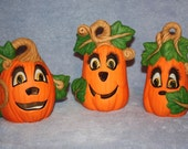 Jack O Lantern Three Piece Set comes with 3 lighted pumpkins with different expressions