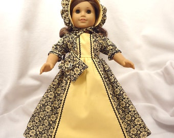 Yellow floral on black, long dress for 18 inch dolls, with yellow inset and black baby rick rack trim.