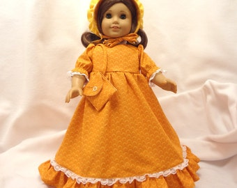 Yellowish orange, long dress for 18 inch dolls, with white lace trim.