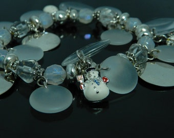 Charm Bracelet With Snowmen, Clear And Frosted Disks And Beads With Silver Spacers