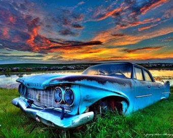 Fine Art print of a 1957 Plymouth sedan sits rusting away forgotten in a farmers field