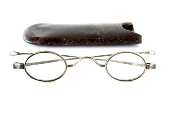 vintage antique oval wire rimmed reading glasses and leather