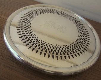 Round silver footed trivet.  Small round footed tray.