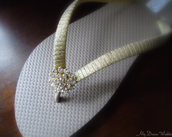 Gold Flip Flops. Tan flip flops with golden ribbon. CZ crystal button on a 18kg plated base .Other colors available-Simple BELLA-Golden