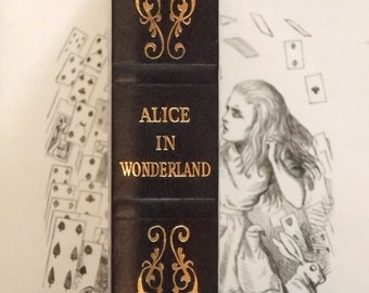 Lewis Carroll omnibus Alice in Wonderland book bound in faux leather