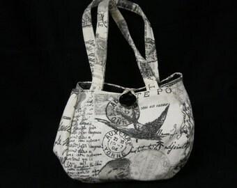 Script black and cream purse