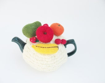Tea cosy cream with mini fruits on top to fit a 4-6 cup pot.knitted