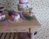 cake with lavender flowers tree floors and pink pois dots and green ribbon-scale 1.12-doll house miniature