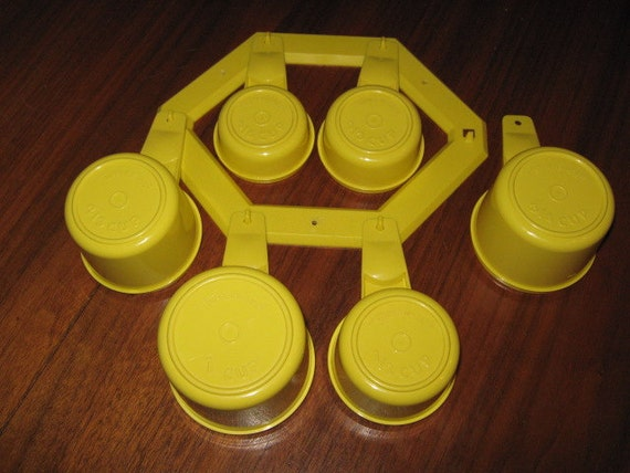 Vintage Yellow Tupperware Measuring Cups And Wall Mount Holder