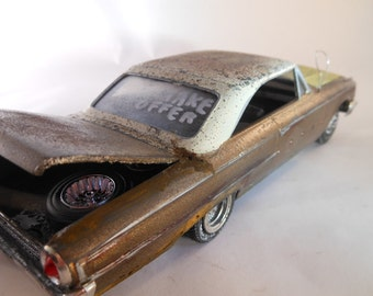 Scale Model Ford Car in Gold and White Classicwrecks