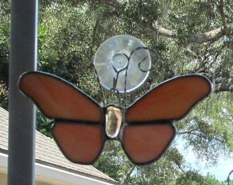 "Stained Glass Orange/White Swirled Opalescent Glass Butterfly 5"" x 3.5"" Suncatcher with Oval Gem Center and Curly Antenae"