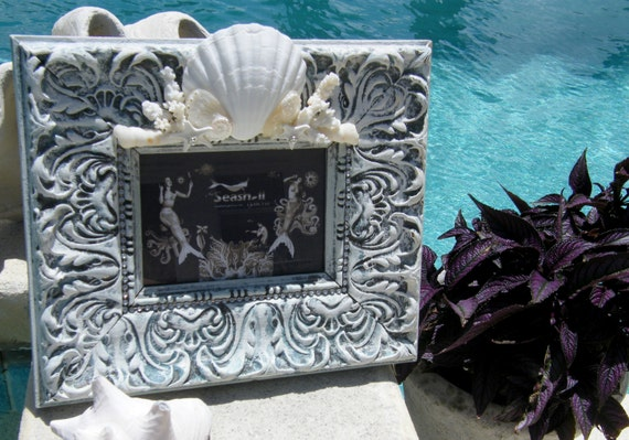 Gallery Frame Embellished with Seashells and Coral Pieces for Coastal Home Decor look.