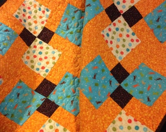"""Frogs, Dots and Circles Jump and Swirl Together In This 39"""" X 39"""" Quilt For Baby Boys"""