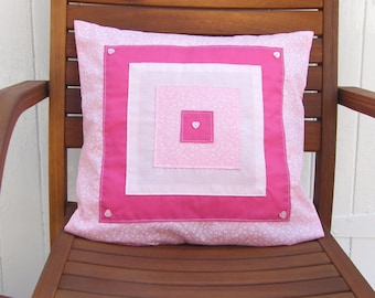 Pinks abstract appliqued cushion cover, throw pillow, pillow sham, 16in x 16in. Square appliqued pattern with buttons.