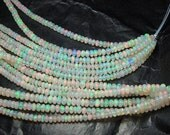 Beautiful genuine full fire white  Ethiopian Opal facet rondelle, size 4 mm sold by set of 10 beads