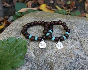 Single Pinky promise Yogi inspired Buddha bracelet with wood beads, turquoise beads and charms