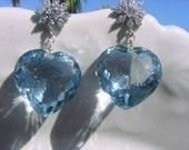 Dazzling sky blue topaz hearts with rhinestone silver studs
