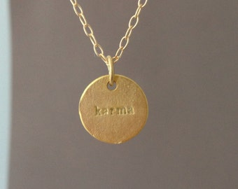 Karma Circle Disc Necklace available in gold or silver