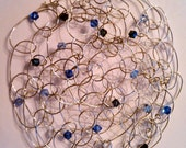 Silver wire kippah with various shades of blue and clear crystals