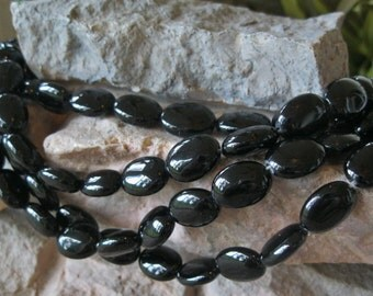 """12 Black Onyx Beads 12MM X 16 MM Oval Natural Polished Stones 7.5"""""""