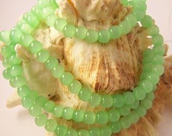 "Light Green Milk Glass Beads - 6mm - 14"" Strand"