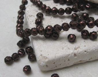 4mm Glass Baroque Pearl Beads in Deep Bronze.  3 dz.