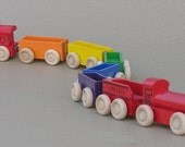 Wooden Toy Rainbow Train with red locomotive.
