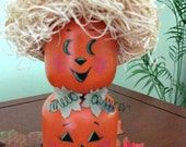 A pumpkin tier, straw hat, leaves, fall,halloween, handpainted