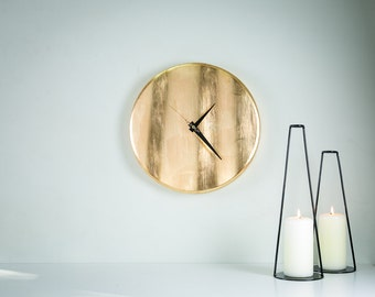 Wall clock Golden wave. Hand gilded by thin yellow metal leaves. NOT gold.