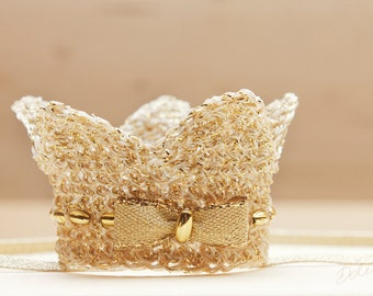 Baby girl gold Crown. Newborn baby crown decorated with gold bow