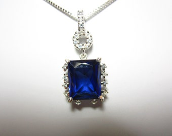 Lab Grown Blue Sapphire and White Topaz Pendant