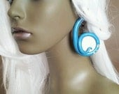 Shimmery turquoise ear plug with Swarovski crystals