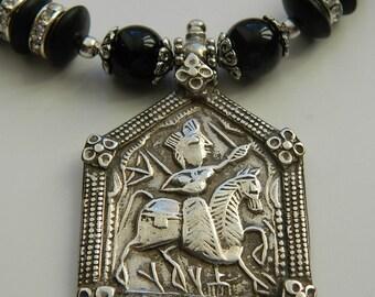 AWESOME  imposing  Rajastani silver amulet on black necklace