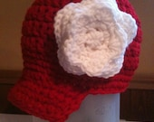 Newsboy hat with flower accent