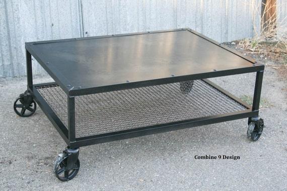 industrial coffee table steel casters reclaimed wood. Black Bedroom Furniture Sets. Home Design Ideas
