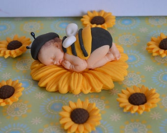 Sleeping baby bee cake topper with extra sunflowers