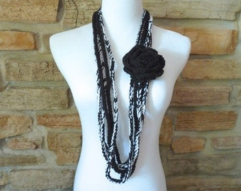 Womens crochet black and white infinity chain scarf handmade in black and white with black flower pin