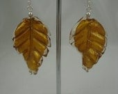 Gorgeous gold foil twisted leaf earrings set on sterling silver earwires