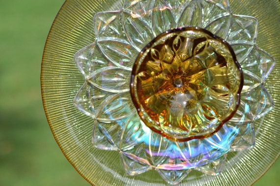 Unavailable listing on etsy for Garden art from old dishes