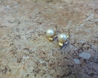 Petite Trifari clip on earrings in gold tone metal with  lovely pearls