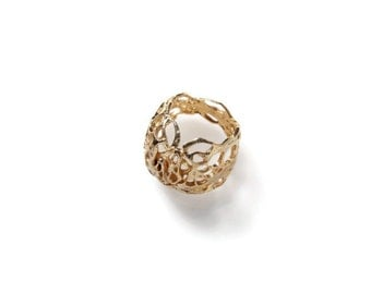 Gold statement ring.Bomabrain ring from the sabrawear collection.