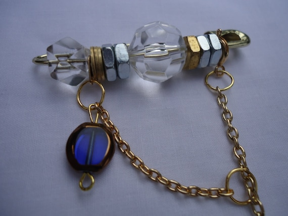 The Winter Crescent: pin with curved hammered silver cylinder, sapphire and copper beads, gold chain