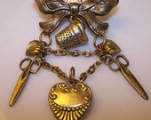 Vintage Gold Tone Metal Sewing Brooch/Pin with Bow, Hearts, Thimble, and Scissors was 15.00 now 10.50