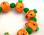 Handmade Halloween Pumpkin Bracelet - Funny Polymer Clay Faces on Every Bead - Orange and Green - Fuffalumps