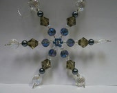 A Glass Bead Snowflake Ornament/Decoration in Blue & Smoke Colors